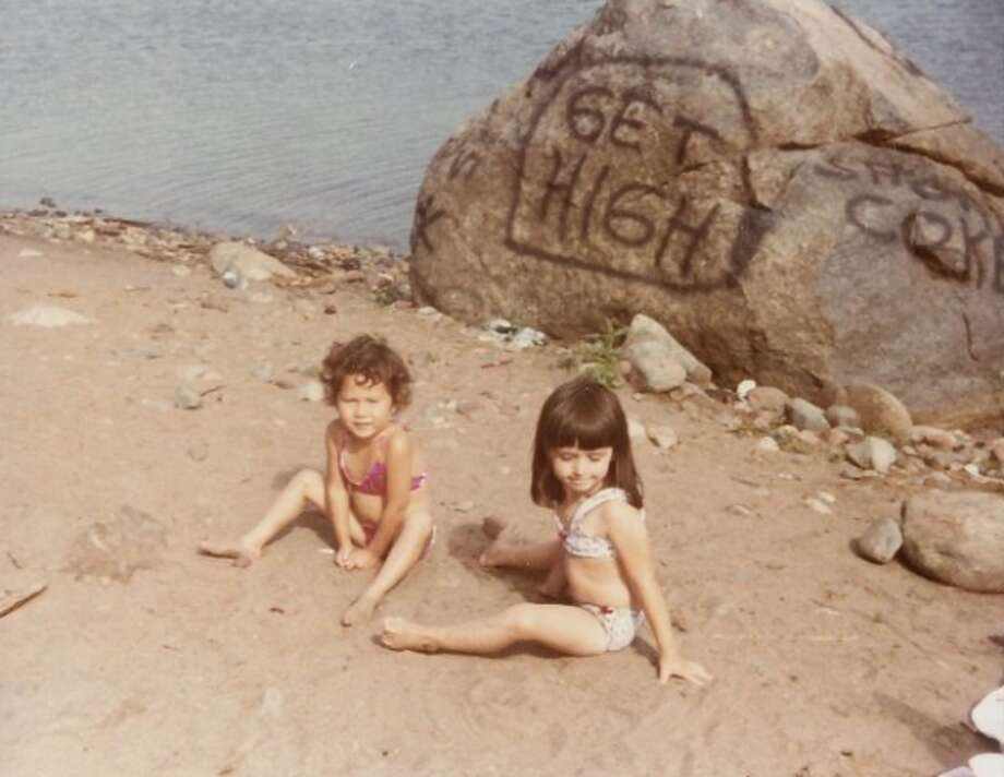 Nobody noticed what was written on the rock until looking at the vacation photos. Photo: Awkward Family Photos