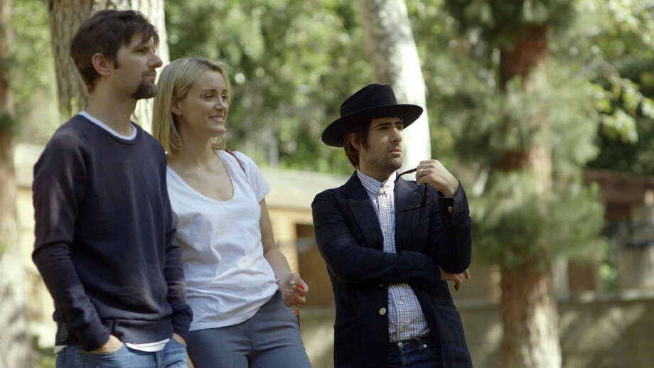 "This photo provided by courtesy of The Orchard shows, from left, Adam Scott, Taylor Schilling, and Jason Schwartzman, in a scene from the film, ""The Overnight."" The movie opens in U.S. theaters on Friday, June 19, 2015.  (John Guleserian/The Orchard via AP) Photo: John Guleserian, HONS / Associated Press / The Orchard"