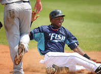Bridgeport outfielder Welington Dotel slides into third base with a triple during the Bluefish afternoon game with Southern Maryland. Bridgeport lost the game 7-2.