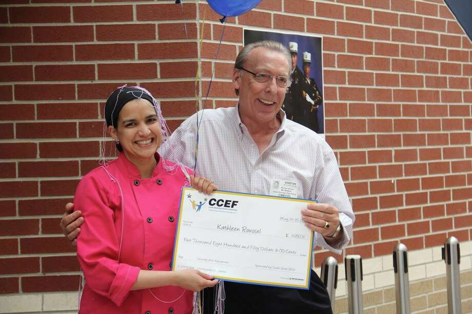 Chef Kathleen Roussel of Clear Springs High School is congratulated by Mickey Wooten, owner of South Shore Grille in League City, who sponsored her $4,850 grant. The Clear Creek Education Foundation visited 59 CCISD teachers on 33 campuses during the annual Sur-Prize Patrol May 14-15. Teachers were surprised by CCEF board members and community partners with 65 teacher innovative grants totaling more than $150,000 Chef Kathleen Roussel of Clear Springs High School is congratulated by Mickey Wooten, owner of South Shore Grille in League City, who sponsored her $4,850 grant. The Clear Creek Education Foundation visited 59 CCISD teachers on 33 campuses during the annual Sur-Prize Patrol May 14-15. Teachers were surprised by CCEF board members and community partners with 65 teacher innovative grants totaling more than $150,000 Photo: Clear Creek Education Foundation