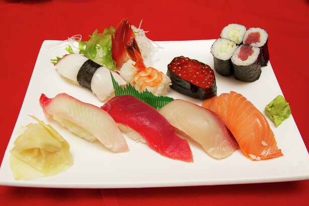 A sushi mix of snapper, tuna, yellowtail, smoked salmon, octopus, shrimp, salmon roe, cucumber roll and tuna roll