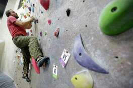 Ryan Welborn of The Woodlands is shown bouldering, a harness-free style of climbing, at inSPIRE Rock, 403 E. Louetta Rd., a rock climbing gym, is shown Friday, June 26, 2015, in Spring. ( Melissa Phillip / Houston Chronicle )