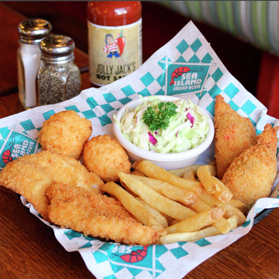 "Sea Island Shrimp House presents its ""Crispy Catch"" platter that features two white fish fillets and two stuffed shrimp, quick-fried in crunchy panko crumbs and paired with french fries, homemade coleslaw, and two hushpuppies. Photo: Courtesy Photo"