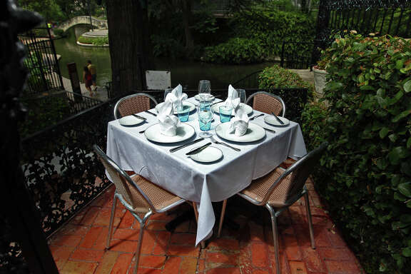 """Fig Tree's """"best table"""" along the River Walk."""