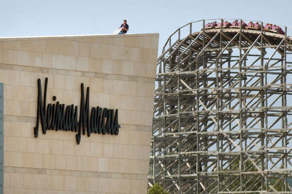 A worker sits atop the new Neiman Marcus store at The Shops at La Cantera, which is close to Six Flags Fiesta Texas on San Antonio's Northwest Side.