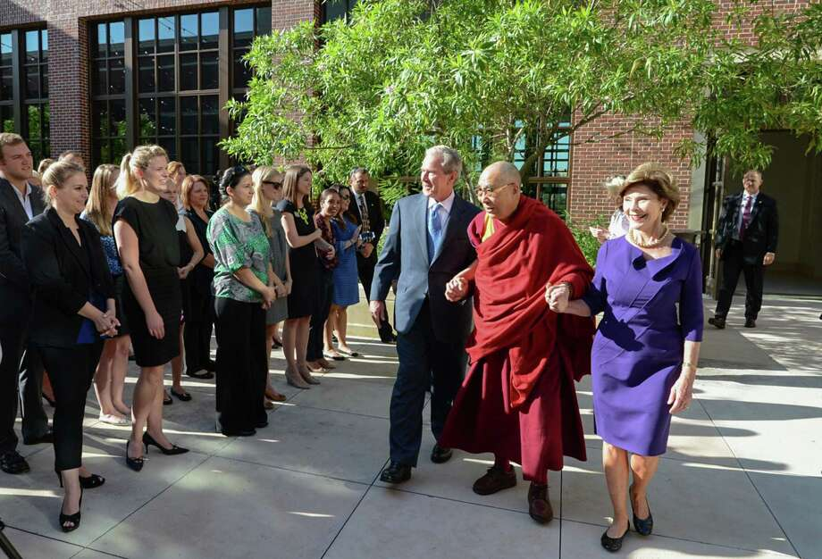 His Holiness the 14th Dalai Lama visits Dallas for a moderated conversation at Southern Methodist University and a stop at the George W. Bush Presidential Center on campus, July 1, 2015. Photo: Grant Miller For The George W. Bush Presidential Center