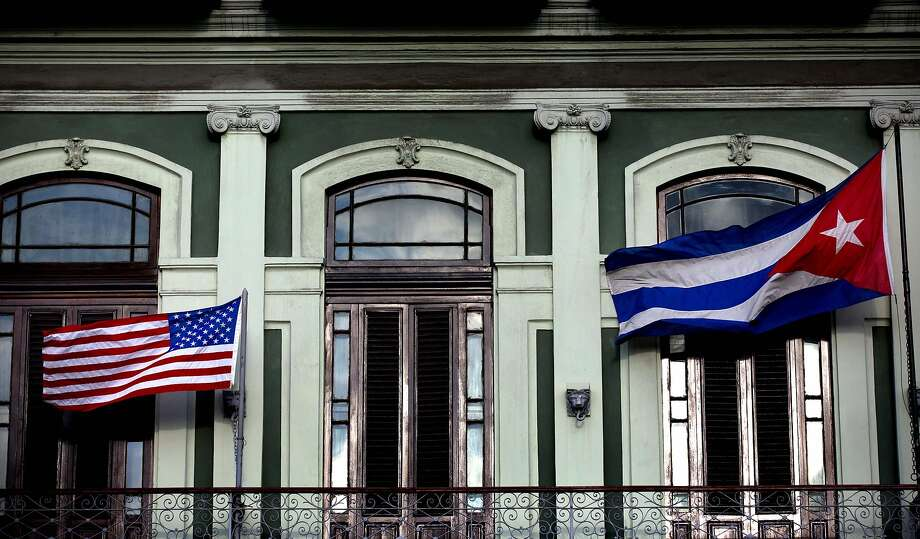 FILE - In this Jan. 19, 2015 file photo, a Cuban and American flag wave from the balcony of the Hotel Saratoga in Havana. President Barack Obama will announce July 1 that the U.S. and Cuba have reached an agreement to open embassies in Havana and Washington, a senior administration official said.  (AP Photo/Ramon Espinosa, File) Photo: Ramon Espinosa, Associated Press