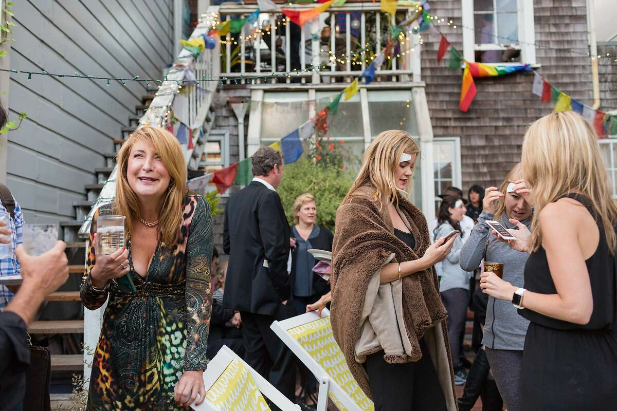 Susan MacTavish Best, left, mingles with guests at her home during an event for the Thync neuro-stimulating mood changing wearable device in San Francisco, Calif., Tuesday, July 1, 2015.