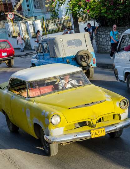 After the Communist government implemented economic changes, many Cubans went into the business of t