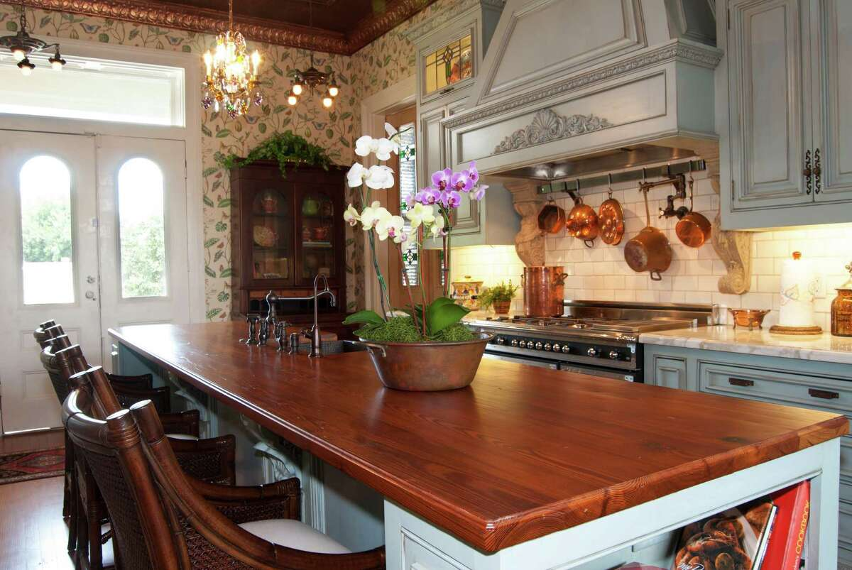 Chuck and Debbie Morris expanded the kitchen, which was added in 1879, and had the custom cabinets painted, glazed and antiqued. Most of the counters are marble, but the island is topped with antique pine.