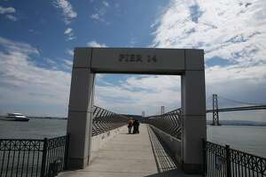 Woman mourned, suspect named after random killing on S.F. pier - Photo