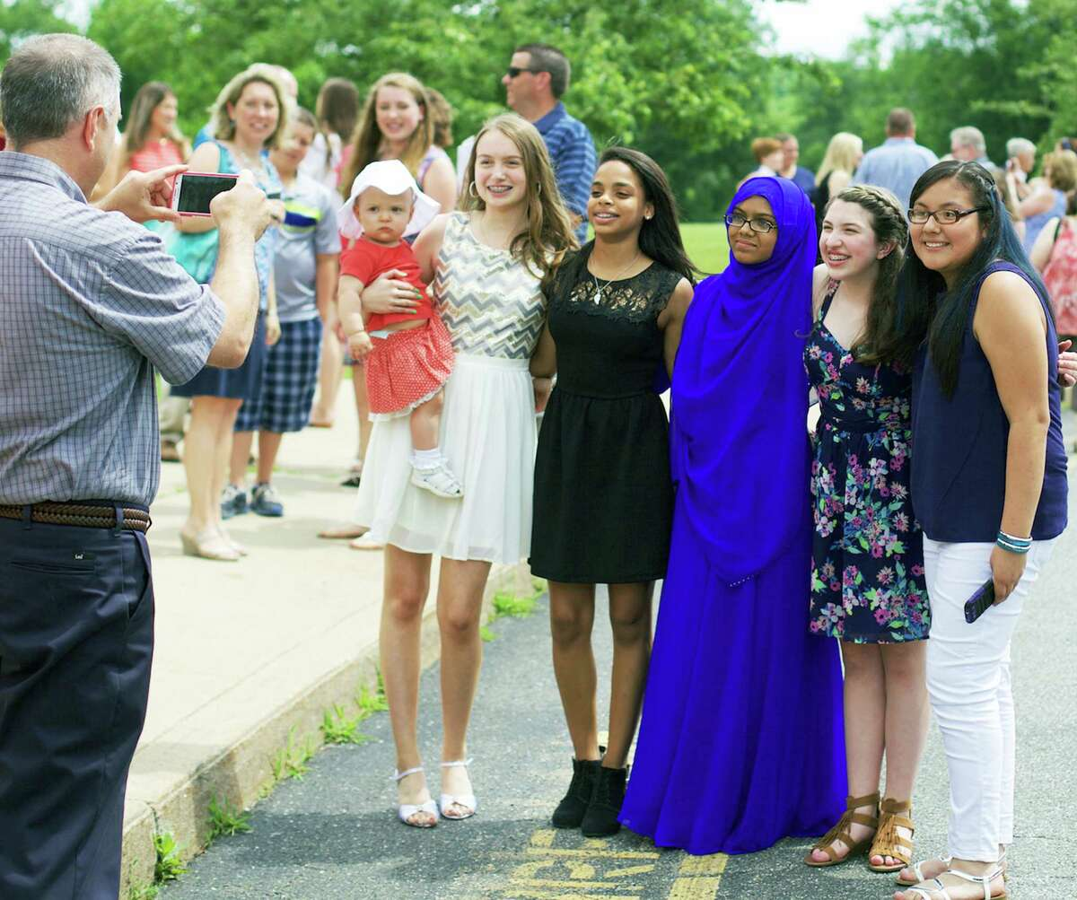 Enjoying the occasion following the Team Red promotional ceremony at Schaghticoke Middle School in New Milford, June 16, 2015, are, from left to right, Gracie Longinotti, 1, Vera Hudson, Joanne Ortiz, Satil Moni, Julia March and Nelly Romano.