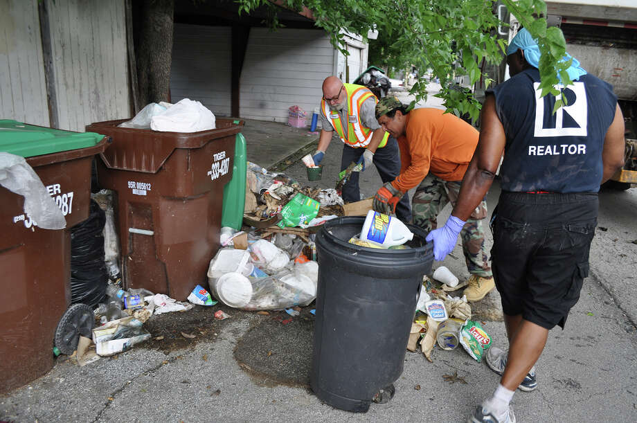 A better solution than either a city/county pilot program or the periodic cleanups that have occurred — shown here — is legislation requiring landlords in such neighborhoods to provide trash service. Such costs could be rolled into rents. Photo: JOSH BRODESKY /San Antonio Express-News / San Antonio Express-News