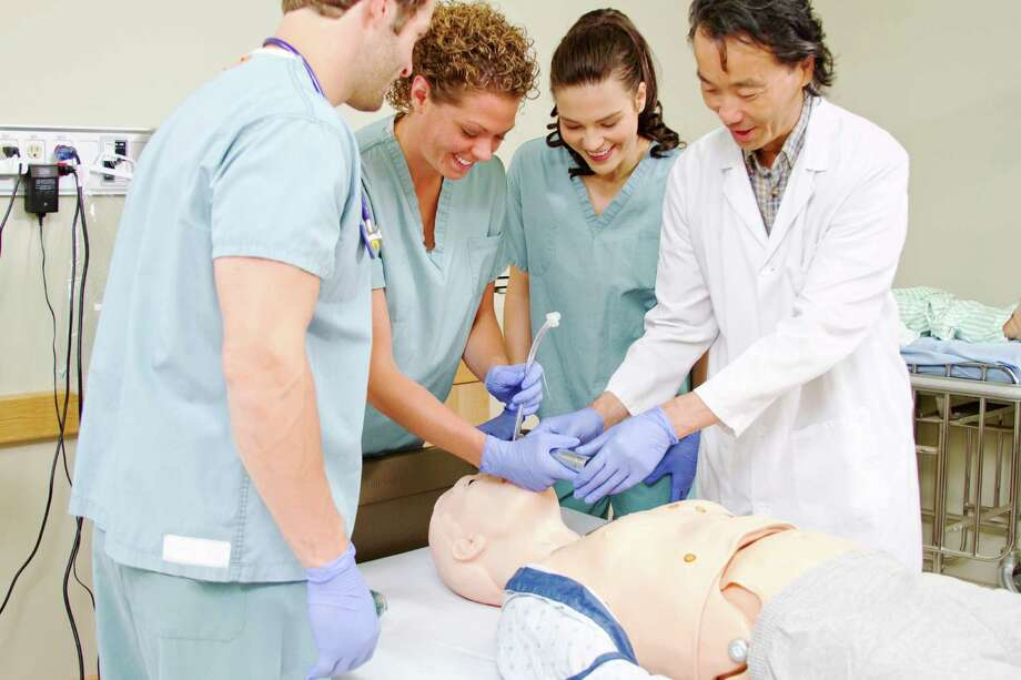 Colleges and universities are challenged to find new and innovative ways to draw people into careers in health care education roles. / iStockphoto