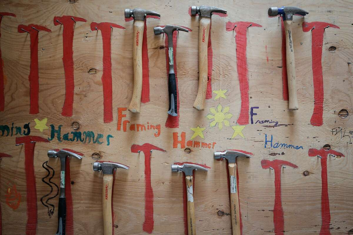 """Hammers are seen in the """"building and construction trades lab"""" at O'connell High School in San Francisco, California, on Thursday, July 2, 2015. In the course, students participate in the construction of a tiny home and nearby compost bins."""