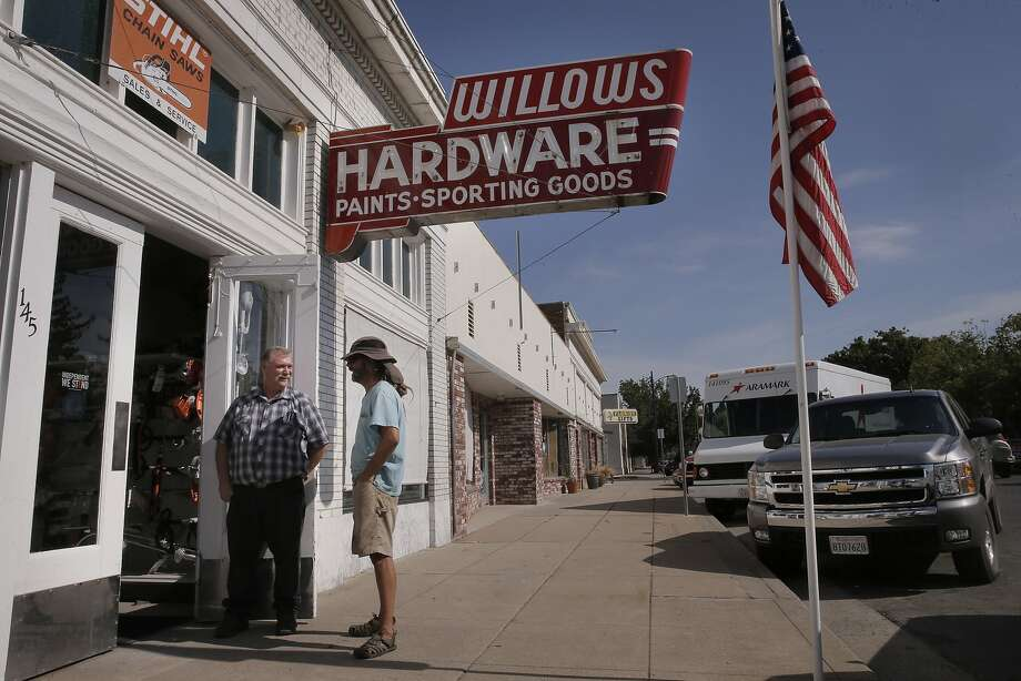 Chuck Bodie a clerk at Willows Hardware with customer Chad Holvik, a local landscaper, outside their shop in downtown Willows, Calif., on Thurs. July 2, 2015. Photo: Michael Macor