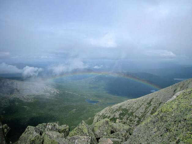 This Aug. 27, 2014 photo shows a rainbow viewed from the top of Mount Katahdin in Baxter State Park in Maine. Katahdin is nearly a mile high and is the tallest mountain in Maine. Weather is unpredictable on the mountain, and what starts out as a balmy summer day can easily include rain, hail and 40 mph winds on the way up. (AP Photo/Beth J. Harpaz) ORG XMIT: MER2015062419363696 Photo: Beth J. Harpaz / AP