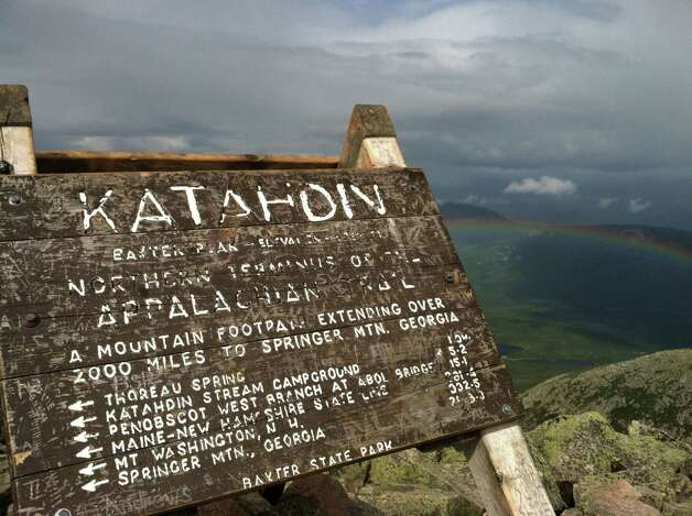 This Aug. 27, 2014 photo shows the weather-worn sign at the peak of Mount Katahdin in Baxter State Park in Maine. Katahdin, the tallest mountain in Maine, is nearly a mile high and is the northern terminus of the Appalachian Trail. (AP Photo/Beth J. Harpaz)  ORG XMIT: MER2015062419353290 Photo: Beth J. Harpaz / AP