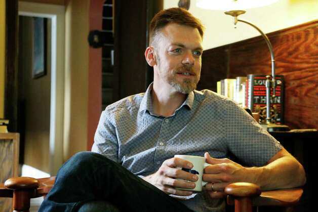 """Dennis Mahoney, author of """"Bell Weather,"""" sits inside his home on Friday, June 26, 2015, in Troy, N.Y. (Olivia Nadel/ Special to the Times Union) Photo: ON / 00032395A"""