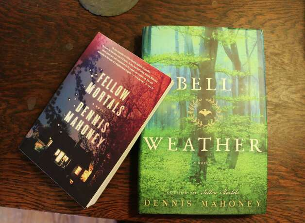 """The two books Dennis Mahoney has written, """"Bell Weather,"""" and """"Fellow Mortals,"""" sit on a table inside his home on Friday, June 26, 2015, in Troy, N.Y. (Olivia Nadel/ Special to the Times Union) Photo: ON / 00032395A"""