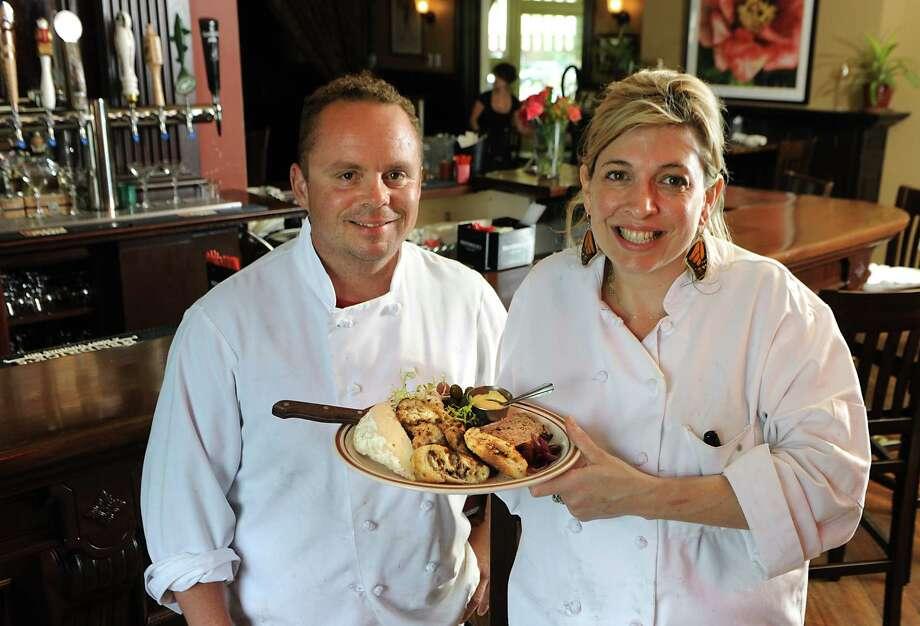 Co-owner chefs Steve and Rebecca Butters with a p‰tŽ board in Morgan & Co restaurant on Thursday, June 25, 2015 in Glens Falls, N.Y. (Lori Van Buren / Times Union) Photo: Lori Van Buren / 00032375A