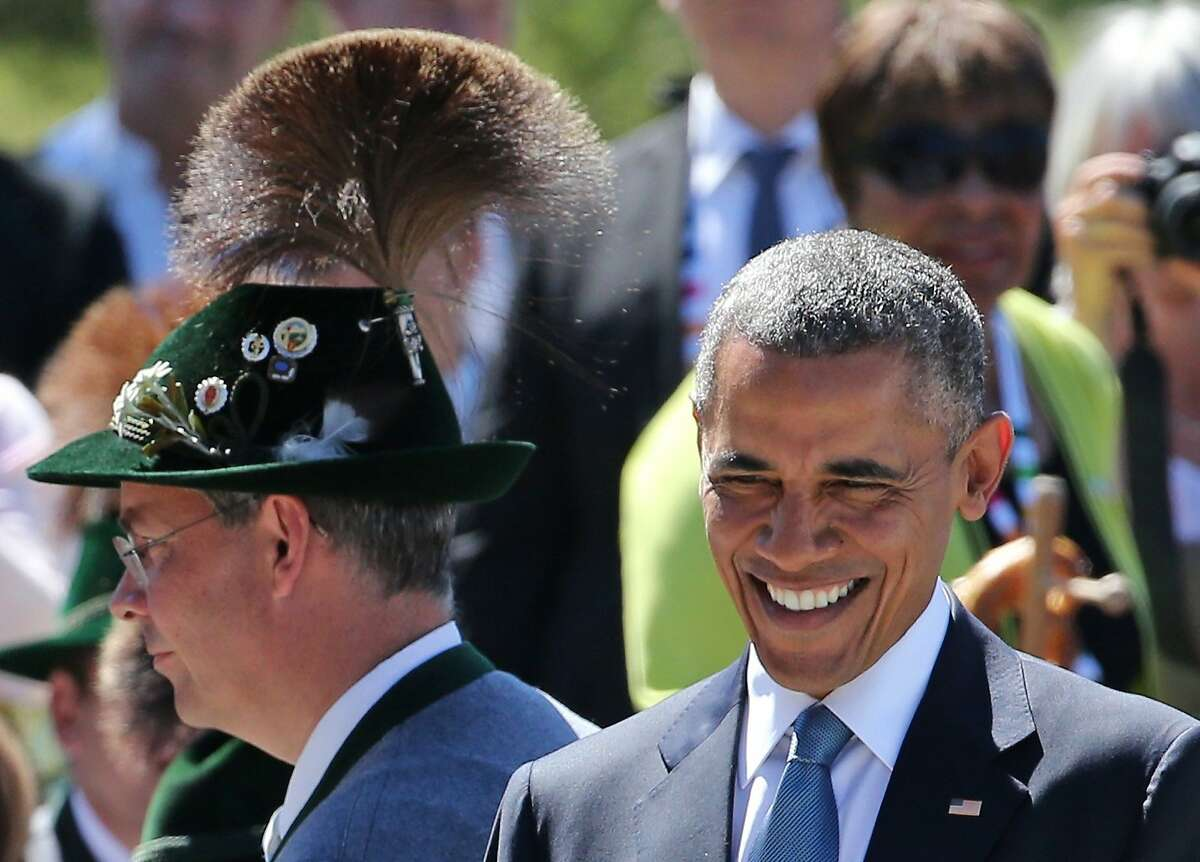 US President Barack Obama (L) smiles upon arrival at a breakfast meeting with German Chancellor and local citizens in Kruen near Garmisch-Partenkirchen, southern Germany, on June 7, 2015 before the start of a G7 summit. Germany hosts a G7 summit at the Elmau Castle on June 7 and June 8, 2015. AFP PHOTO / POOL / DANIEL KARMANNDANIEL KARMANN/AFP/Getty Images