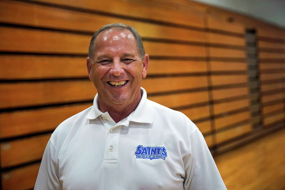 Jack Hank, athletic director at Our Lady of the Lake University, stands for a portrait in Mabee Gymnasium on campus in San Antonio. Photo: Ray Whitehouse /San Antonio Express-News / 2015 San Antonio Express-News