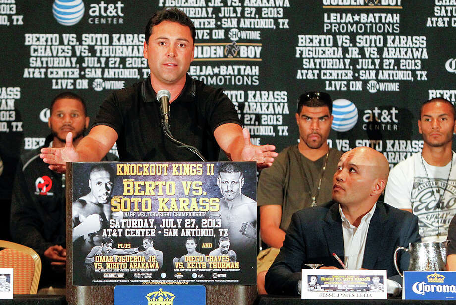 """""""Jesse"""" James Leija (second from right) listens to Oscar De La Hoya speak during the final press conference for Knockout Kings II at the San Antonio Marriott Rivercenter on July 25, 2013. Photo: Marvin Pfeiffer /San Antonio Express-News / Express-News 2013"""