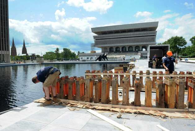 Crews from Santore's World Famous Fireworks put together launch platforms in preperation for the Price Chopper presented New York State's Fourth of July Celebration at the Empire State Plaza on Thursday, July 2, 2015, in Albany, N.Y.  (Michael P. Farrell/Times Union) Photo: Michael P. Farrell / 00032474A