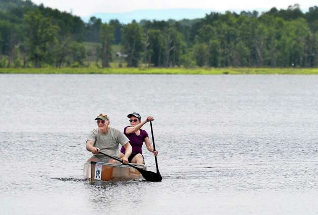 Husband and wife paddlers Dave, left, and Connie Stitt of Ballston Lake practice for the upcoming 90-mile ADK Canoe Classic on Round Lake Thursday July 2, 2015 in Round Lake, NY.  (John Carl D'Annibale / Times Union) Photo: John Carl D'Annibale