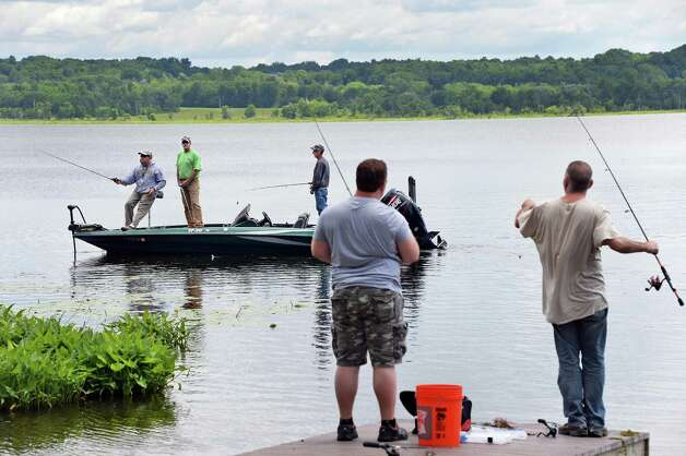 Fishermen take advantage of the break in the weather to try their luck at Round Lake Thursday July 2, 2015 in Round Lake, NY.  (John Carl D'Annibale / Times Union) Photo: John Carl D'Annibale