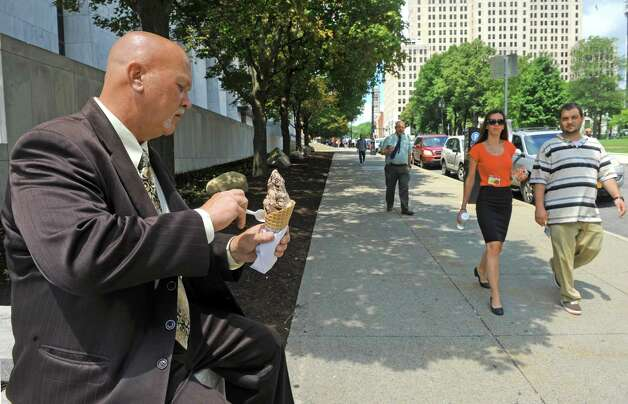 Brian Sikorski of Guilderland enjoys a cone of chocolate ice cream for lunch at the Empire State Plaza on Thursday July 2, 2015 in Albany, N.Y.  (Michael P. Farrell/Times Union) Photo: Michael P. Farrell