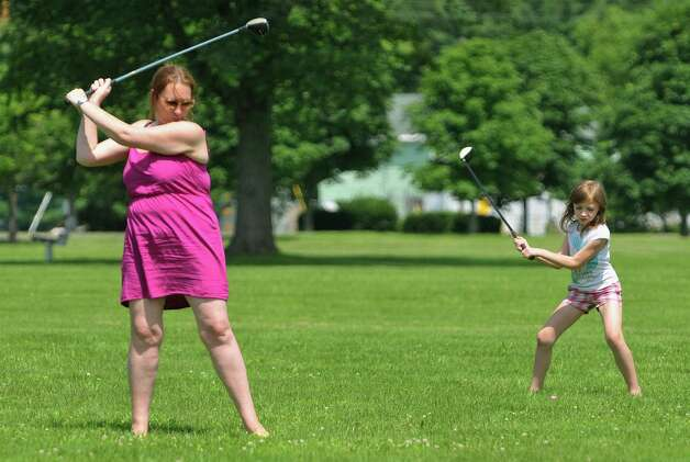 Sandra Comenole, left, of Wynantskill and her daughter, Penelope, 7, practice their golf game at Schuyler Flatts Cultural Park on Thursday, July 2, 2015, in Watervliet, N.Y.   (Paul Buckowski / Times Union)