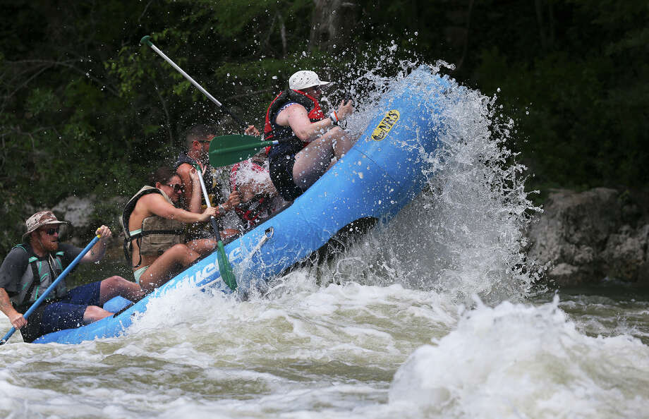 As recently as two weeks ago, the Guadalupe River was running at 5,000 cubic feet per second, capable of springing a raft in the air at Hueco Falls, but the Canyon Lake outflow has been reduced to 400 cfs, perfect for inner tubers for the holiday weekend. Photo: Tom Reel /San Antonio Express-News
