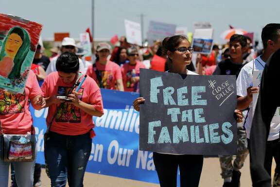 Hundreds march toward the Dilley immigrant detention center during a May 2 march and protest. Migrants fleeing violence and oppression are now being held in detention.