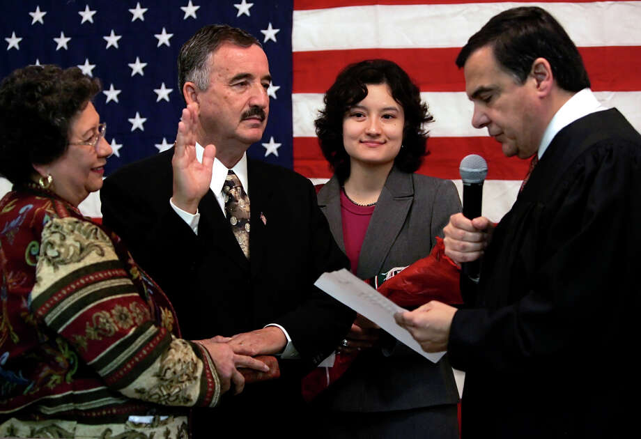 U.S. District Judge Orlando Garcia administers the oath of office in 2007 to Rep. Ciro Rodriguez, D-Texas. Garcia was appointed by President Bill Clinton in Photo: William Luther /AP / THE SAN ANTONIO EXPRESS-NEWS