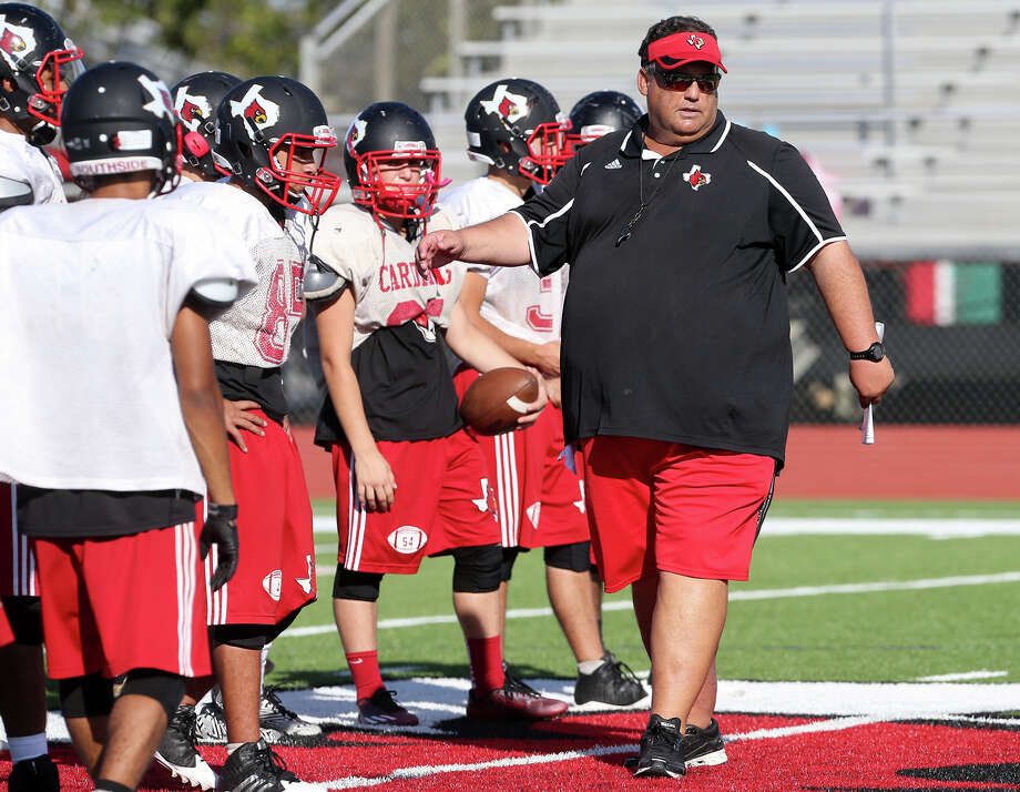 Southside High School head coach Ricky Lock directs his football team during a practice session in 2014. A reader says the University of Louisville is being a bully in the controversy over the mascot used by the high school, which is similar to the university logo. Photo: MARVIN PFEIFFER /San Antonio Express-News / Express-News 2014
