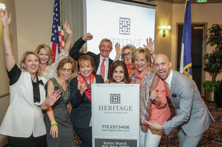 Heritage Texas Properties introduced its new look, a new logo and brand identification. It was revealed at a gathering of all Heritage Texas Properties agents and employees. Left to right are Kirsten Abney, Christi Aufdenspring, Rebecca Trahan, Robin Mueck, Jerry Mueck, Jaclyn Reed, Phyllis Childress, Chaille Ralph, and Mike Mahlstedt.