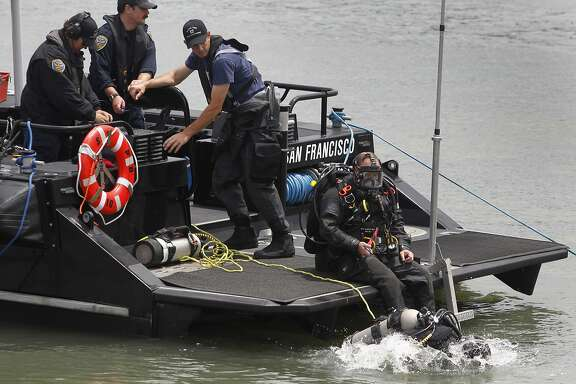 A police department scuba diver enters the bay to search for evidence off Pier 14 in San Francisco, Calif. on Thursday, July 2, 2015 after a woman was shot and killed walking on the pier with her father yesterday afternoon.