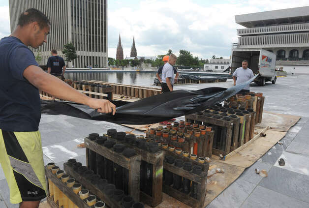 Crews from Santore's World Famous Fireworks put together launch platforms in preperation for the Price Chopper presented New York Stateís Fourth of July Celebration at the Empire State Plaza on Thursday July 2, 2015 in Albany, N.Y.  (Michael P. Farrell/Times Union) Photo: Michael P. Farrell, Albany Times Union / 00032474A