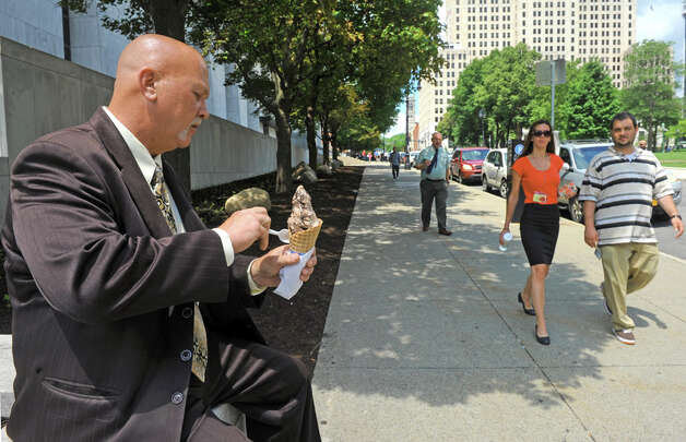Brian Sikorski of Guilderland enjoys a cone of chocolate ice cream for lunch at the Empire State Plaza on Thursday July 2, 2015 in Albany, N.Y.  (Michael P. Farrell/Times Union) Photo: Michael P. Farrell, Albany Times Union