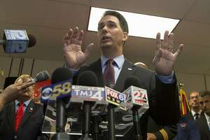 Wisconsin lawmakers give Walker wins on gun sales, union dues - Photo