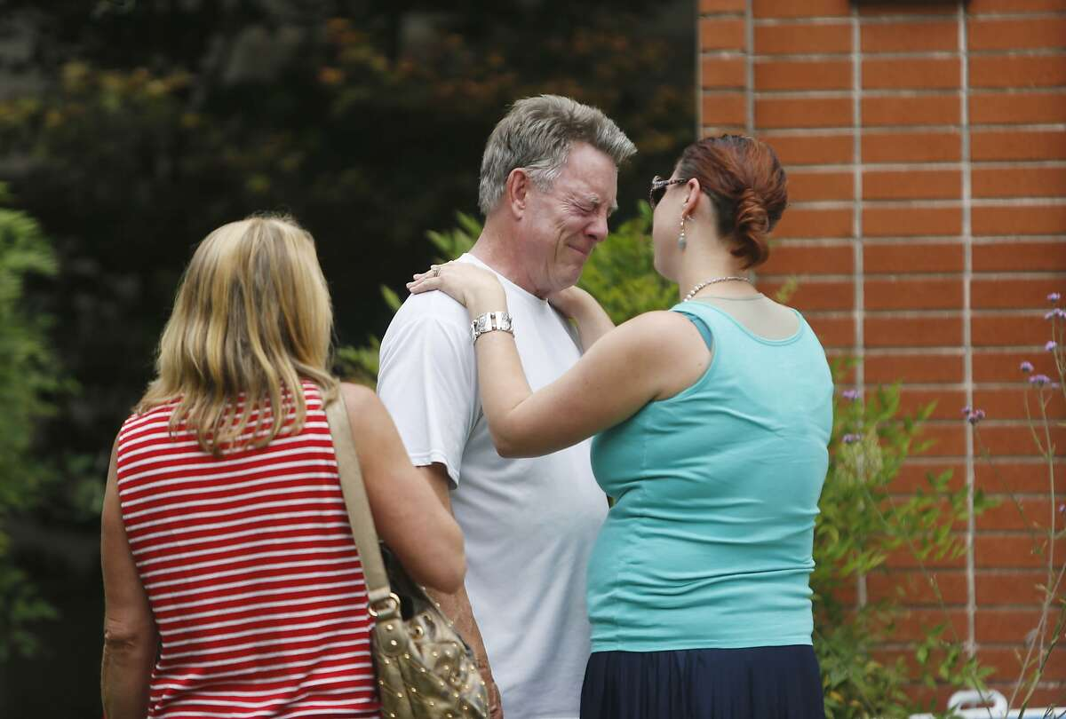 Family friends hugs Jim Steinle (center) outside the family home of Kathryn Steinle on Thursday, July 2, 2015 in Pleasanton, Calif.