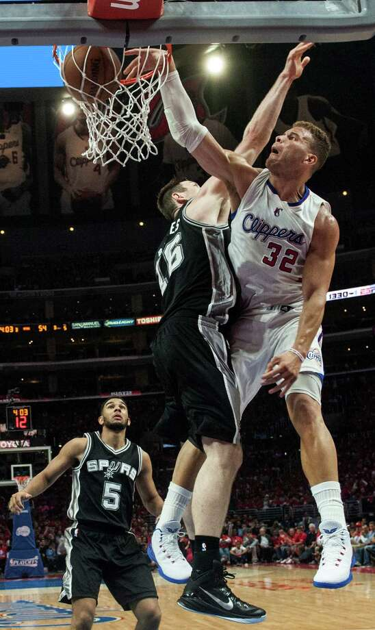 Los Angeles Clippers' Blake Griffin dunks against San Antonio Spurs' Aron Baynes during the second half of Game 1 of a first-round playoff series in Los Angeles on April 19, 2015. Photo: Ed Crisostomo /Associated Press / The Orange County Register