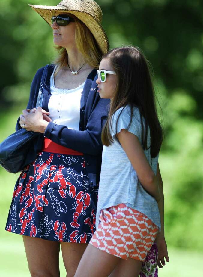 Greenwich's Sydney Nethercott, 12, stands beside her mother while watching the women's town golf tournament at the Griffith E. Harris Golf Course in Greenwich on June 29, 2015. Her sister, Kendyl Nethercott, won the townwide tournament with a score of 85. Photo: Tyler Sizemore / Hearst Connecticut Media / Greenwich Time