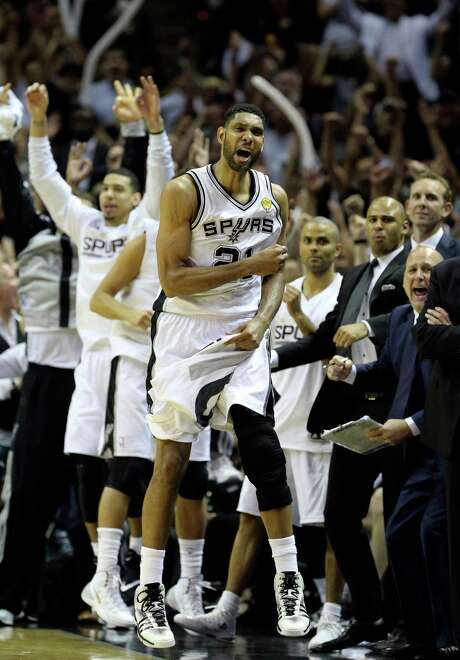 San Antonio Spurs' Tim Duncan celebrates with the bench during second half action in Game 5 of the 2014 NBA Finals Sunday June 15, 2014 at the AT&T Center. Photo: Edward A. Ornelas, Staff / San Antonio Express-News / © 2014 San Antonio Express-News