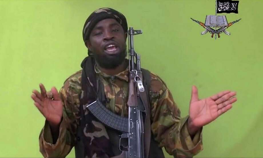Abubakar Shekau is the leader of Boko Haram, which is accused of killing nearly 100 people, most of them men, who were praying in mosques in the city of Kukawa in northeastern Nigeria. Photo: /Associated Press File Photo / Militant Video