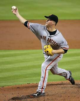 MIAMI, FL - JULY 02:  Matt Cain #18 of the San Francisco Giants pitches during a game against the Miami Marlins at Marlins Park on July 2, 2015 in Miami, Florida.  (Photo by Mike Ehrmann/Getty Images)