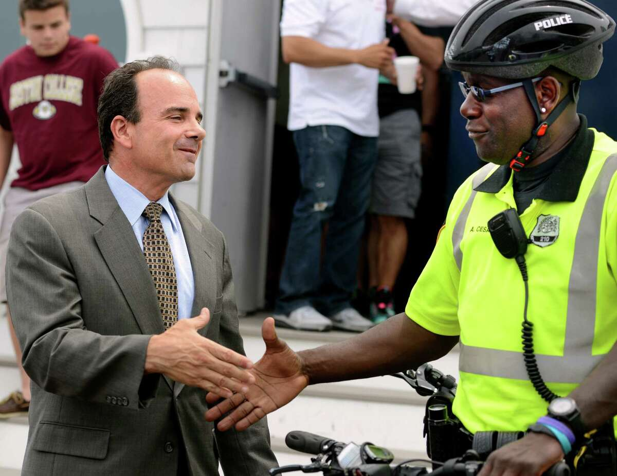 Former Bridgeport Mayor Joseph Ganim, who served seven years in prison for bribery, shakes hands with Bridgeport Police Officer Alfred Cesar Thursday, July 2, 2015, outside Port 5 of the National Association of Naval Veterans in Bridgeport. Following a candidate forum and vote, Bridgeport's police union chose to endorse Ganim in his bid for mayor.