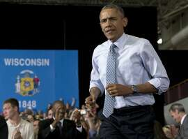 President Barack Obama arrives to speak at the University of Wisconsin at La Crosse, in La Crosse, Wis., Thursday, July 2, 2015, about the economy and to promote a proposed Labor Department rule that would make more workers eligible for overtime. (AP Photo/Carolyn Kaster)